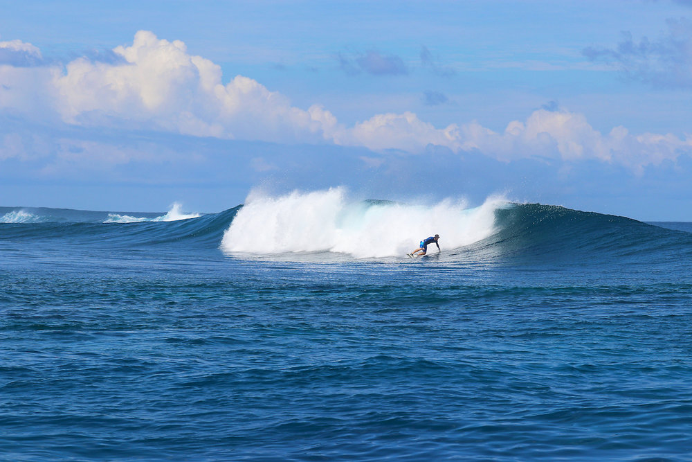 Charlie doing a big bottom turn on the left at E.R., it's always offshore somewhere!