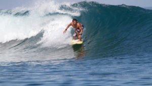 Telo_Island_Lodge_Johnny_Surfing