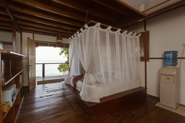Telo_Island_Lodge_Bedroom_Ocean_View