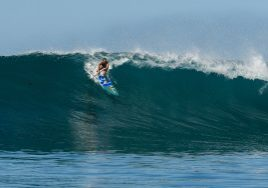 01.-Your-correspondent-Fiona-Wylde-launching-into-her-millionth-dream-wave-at-Tenggara-Point